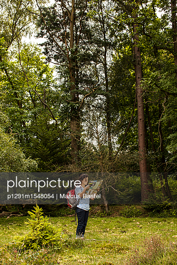 Woman lost in forest - p1291m1548054 by Marcus Bastel