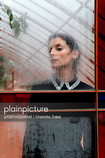 woman behind steamy window - p1521m2228342 by Charlotte Zobel