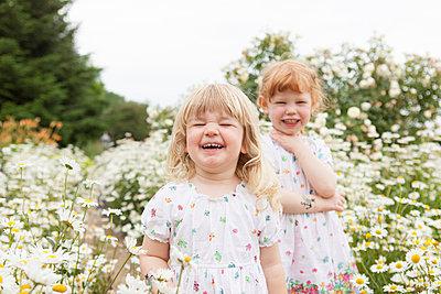 Two girls fooling around - p505m1048194 by Iris Wolf