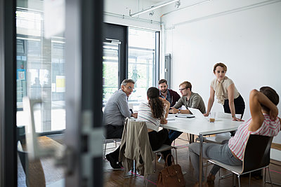 Business people talking in conference room meeting - p1192m1493260 by Hero Images