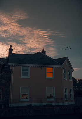 Illuminated residential house at twilight, Strangford - p1681m2283618 by Juan Alfonso Solis