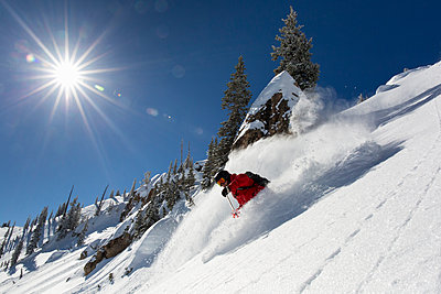 Man skiing in Rocky Point in Alta Ski Resort - p343m1443454 by Wray Sinclair