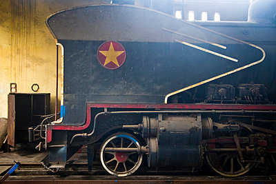 Steam engine in process of being restored at a workshop in the Railway Worker's Khu Tap The, Hanoi, Vietnam, Asia - p934m832494 by Dominic Blewett