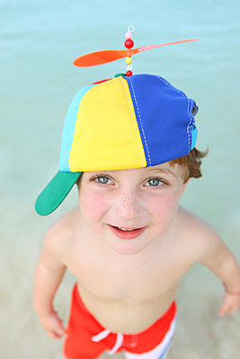 Child with funny hat - p045m892846 by Jasmin Sander