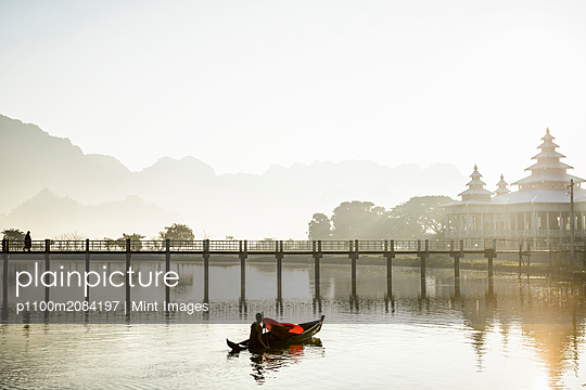 Mountains and bridge reflected in still lake, Hpa an, Kayin, Myanmar,hpaan, Kayin, Myanmar - p1100m2084197 by Mint Images