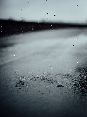 Raindrops splashing on tarmac - p300m1156476 by David Stoll