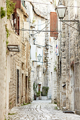 Cobblestone street in old town - p312m1070612f by Michael Jonsson