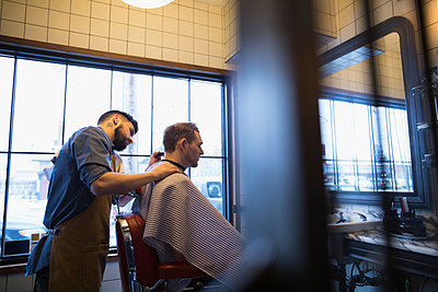 Barber shaving male client - p1192m1231176 by Hero Images