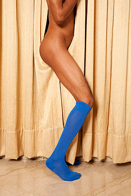 Man wearing blue socks - p817m2008026 by Daniel K Schweitzer