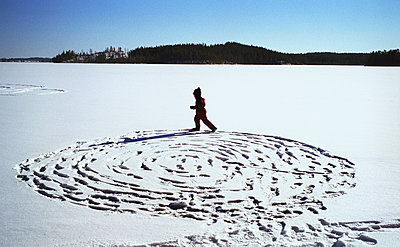 Child Playing In Snow, Sweden  - p847m1529454 by Mikael Andersson