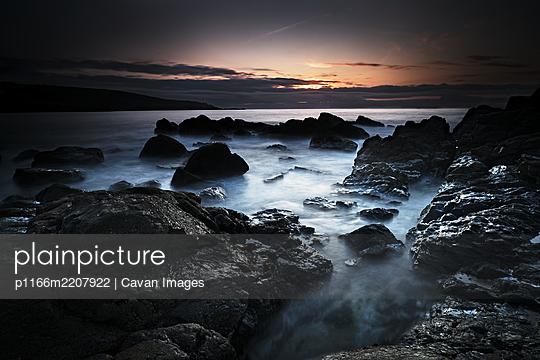 Long Exposure, Rocks, Setting Sun - p1166m2207922 by Cavan Images