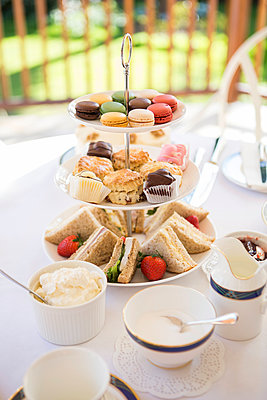 Cake stand with sandwiches, cookies and macaroons - p1026m1164197 by Patrick Frost