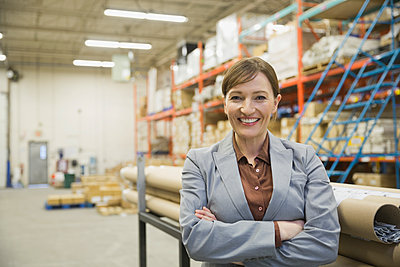 Portrait of confident manager in warehouse - p1192m1219130 by Hero Images