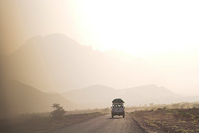 Land cruiser driving along dusty road, between Zagora and Tata, Morocco, North Africa, Africa - p871m1074021f by Jane Sweeney