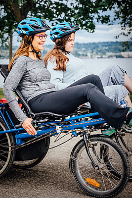 Caucasian mother and daughter riding tandem bicycle - p555m1303903 by Inti St Clair