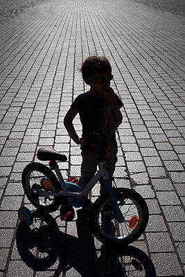 Young boy and his bike - p1028m2026117 by Jean Marmeisse