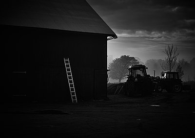 Barn and tractor at sunrise - p312m1121724f by Jan Tove