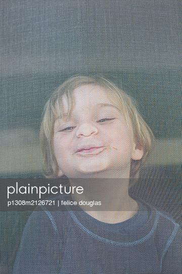 Boy at the window - p1308m2126721 by felice douglas