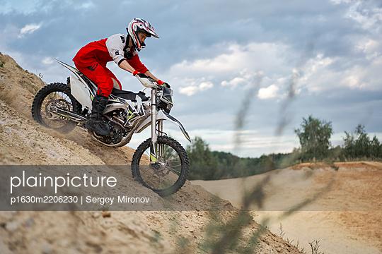 Single motorbiker on motocross racing course downhill - p1630m2206230 by Sergey Mironov