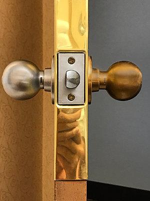 Brass security door handle  - p1048m2025415 by Mark Wagner