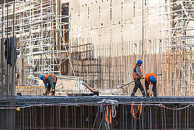 Construction workers on building site - p1292m2151581 by Niels Schubert