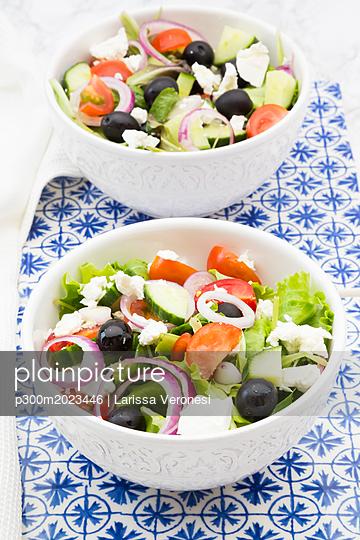 Two bowls of Greek salad - p300m2023446 by Larissa Veronesi