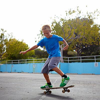 Boy Skateboarding - p1260m1091122 by Ted Catanzaro