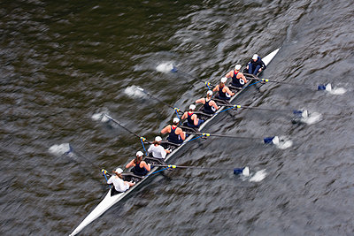 High angle view of Eight rowing on river. - p1100m1570883 by Mint Images