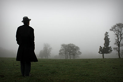 Man with hat on field - p1019m2141652 by Stephen Carroll