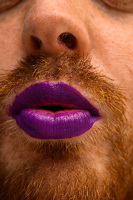 Bearded man with lipstick on - p1628m2288903 by Lorraine Fitch