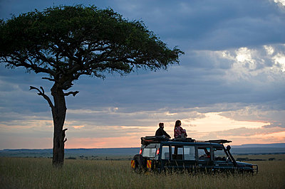 A stop for a break during a game drive in the Mara - p6521205 by John Warburton-Lee