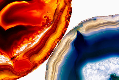 Close-up of agate stones on white background - p301m1130832f by Norman Posselt