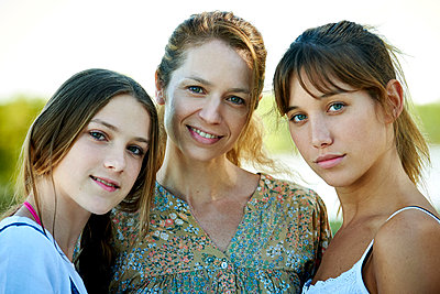Family standing outdoors - p623m2069027 by Eric Audras