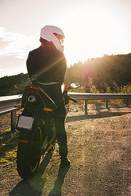 Italy, Elba Island, female motorcyclist at viewpoint - p300m2070129 by Francesco Buttitta
