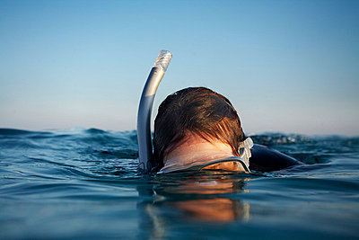 Female snorkeler in the surface - p3434659 by Kennet Havgaard