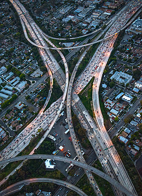 Aerial view of highway interchange in cityscape - p555m1305495 by Chris Sattlberger