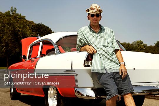 Car Colelctor with Vintage Car