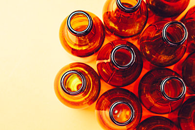 empty and brown glass bottles - p1166m2073578 by Cavan Images