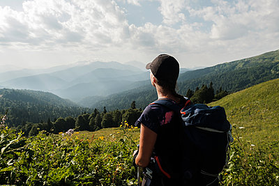 Woman hiker looking at valley, Caucasus Mountains - p1363m2063248 by Valery Skurydin