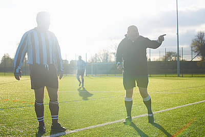 Football players starting game - p429m943145f by Peter Muller