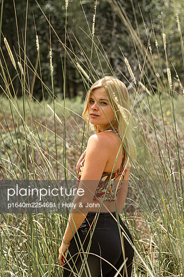 Blond woman in the meadow - p1640m2254651 by Holly & John