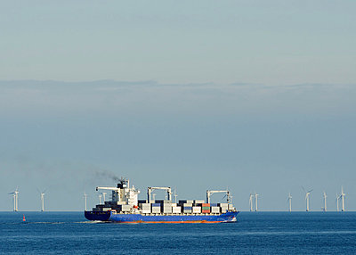 Container ship with windfarm in background, Denmark - p429m803610f by Mischa Keijser