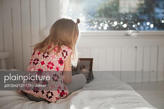 Girl using digital tablet - p312m2121779 by Johner