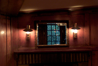 Reflection of pub window at night - p1072m829523 by Tracy Jean Shields