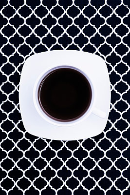 Coffe cup on tablecloth - p1149m1574402 by Yvonne Röder