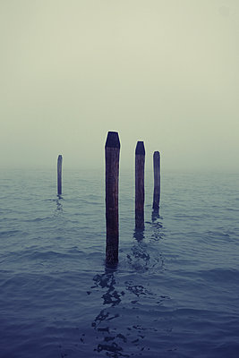 Italy, Venice, Wooden posts in water - p1189m2176223 by Adnan Arnaout