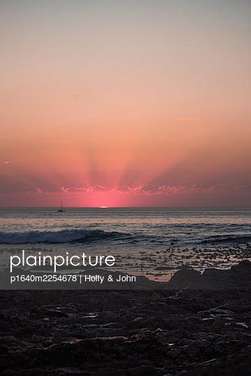 Sailing boat at sunset - p1640m2254678 by Holly & John