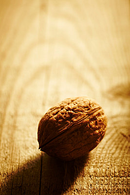 Walnuts on a wooden table - p968m658850 by roberto pastrovicchio