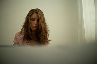 Sad young woman - p1321m2027507 by Gordon Spooner