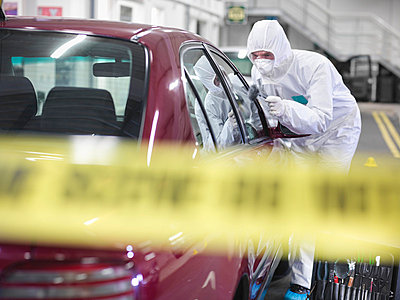 Forensic scientist at crime scene - p429m711795f by Monty Rakusen